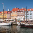 Old boats and houses in Nyhavn in Copenhagen — Stock Photo #28847473