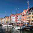 Old boats and houses in Nyhavn in Copenhagen — Stock Photo #28848777