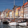 Old boats and houses in Nyhavn in Copenhagen — Stock Photo #28850627