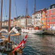 Old boats and houses in Nyhavn in Copenhagen — Stock Photo #28852721