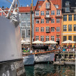 Old boats and houses in Nyhavn in Copenhagen — Stock Photo #28853715