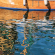 Reflection of an old sailing boat in the water — Stock Photo