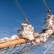 Stock Photo: Gathered sail of big sailing ship
