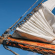 Bowsprit and gathered sail of a large sailing ship — Stock Photo