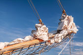 Gathered sail of a big sailing ship — Stock Photo