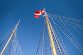Mast and Danish flag on a large sailing — Stock Photo