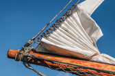 Bowsprit and gathered sail of a large sailing ship — Stockfoto