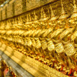 Golden row of Buddhist temple keepers — Stock Photo