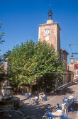 Clock tower and town square of Aiguines — Stock Photo