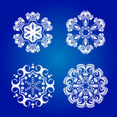 Snowflakes isolated on blue background — Stock Vector