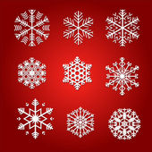 Sneeuwvlokken geïsoleerd op rode achtergrond — Stockvector