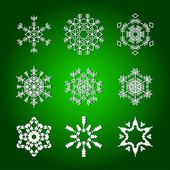 Snowflakes isolated on green background — Stock Vector
