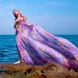 Beautiful Girl With streaming dress on The Beach — Stock Photo