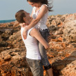 Lovers on the background of the rocks — Stock Photo