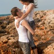Royalty-Free Stock Photo: Lovers on the background of the rocks