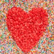Heart shape made of candies - Stock Photo