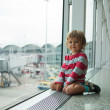 Stock Photo: Happy little kid in airport