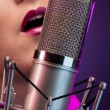 Pretty woman singing on stage - Stock Photo