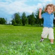 Royalty-Free Stock Photo: Smiling boy running in park