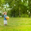 Little boy holding yellow ball — Stock Photo