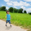 Little boy running in park — Stok fotoğraf