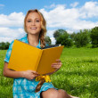 Nice student on the lawn — Stock Photo