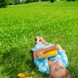 Beautiful girl sleeping on lawn — Stock Photo