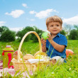 Little boy drinking on picnic — Stock Photo