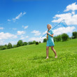 Girl and beautiful countryside landscape — Stock Photo