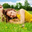 Pretty girl resting on grass — Stock Photo