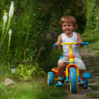 Little boy riding tricycle — Stock Photo