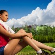Jogger girl taking break - Stock Photo