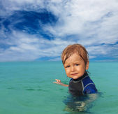 Cute kid in wetsuit — Stock Photo