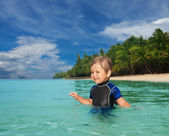 Little boy in the wetsuit — Stock Photo