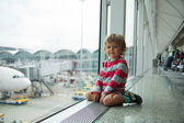 Happy little kid in airport — Stock Photo