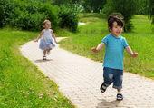 Girl chasing cute boy — Stock Photo