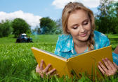 Country girl reading a book — Stock Photo