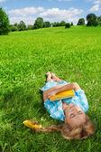 Beautiful girl sleeping on lawn — Stock Photo