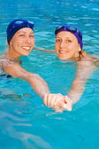 Two girl swimmers in the pool — Stock Photo