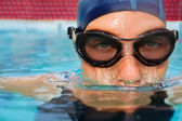 Swimmer woman submerging in pool — Stock Photo
