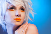 Sexy blond woman portrait on blue — Stock Photo