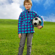 Cute confident boy with ball — Stock Photo