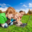Bright kids browsing in park — Stock Photo