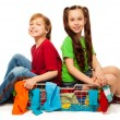 Постер, плакат: Two kids in clothing basket