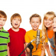 Stock Photo: Group of 8 years old kids with microphone