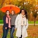 Students walking in autumn park — Stock Photo