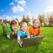 Three happy friends browsing outdoors — Stock Photo #16295151