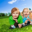Cute brother and little sister in park — Stock Photo