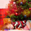 Blond boy overslept Santa — Stock Photo