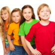 Foto Stock: Five happy kids in colorful shirts